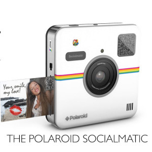 Looking at the Polaroid Socialmatic camera with printer